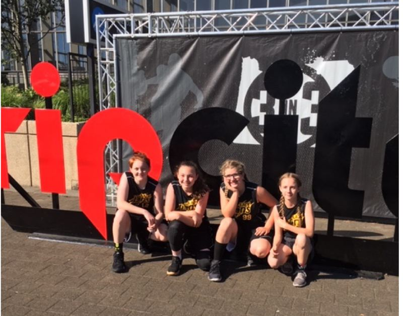 COURTESY PHOTO: ROB MCDOLE - The Lady Lions of St. Helens celebrate after placing sixth in their division of the Trail Blazers-sponsored Rip City 3 on 3 basketball tournament last month at the Rose Quarter. From left: Mia Saalfeld, Maisy McDole, Caitlin Keefe and Audrey Kidd.