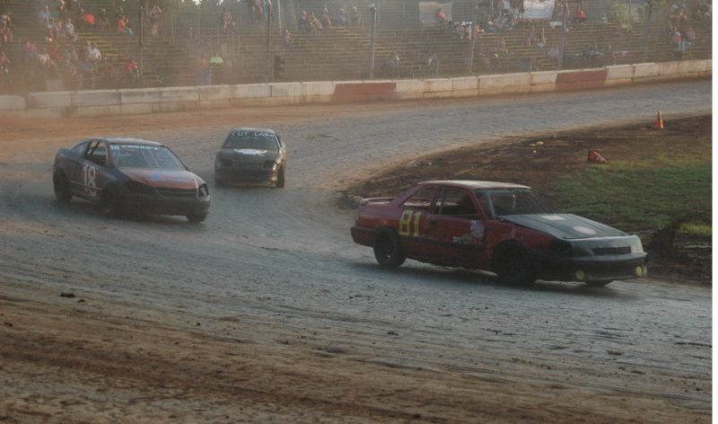 COURTESY PHOTO: MIKE WEBER - Greshams Lynn Yeaman (81) leads Darrin Rye (18), of Warren, in the Tuner Division main event on Aug. 3 at River City Speedway in St. Helens.