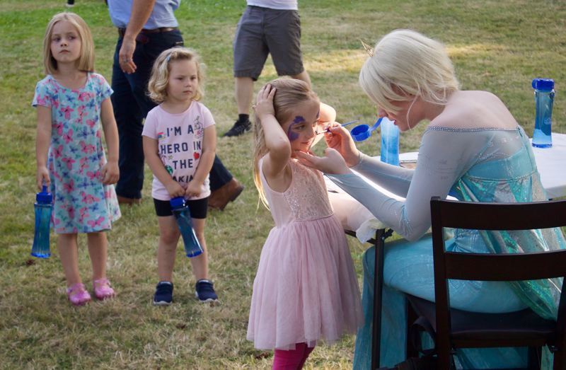PMG PHOTO: CHRISTOPHER KEIZUR - Face painting from a princess was a popular attraction at Kirk Parks National Night Out celebration Tuesday evening, Aug. 6.