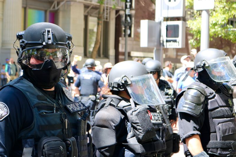 PMG FILE PHOTO - Police in riot gear blockaded streets during a Saturday, June 29, downtown demonstration.