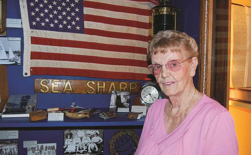 RAMONA MCCALLISTER - Sharon Adams stands next to a display at Bowman Museum depicting her efforts.