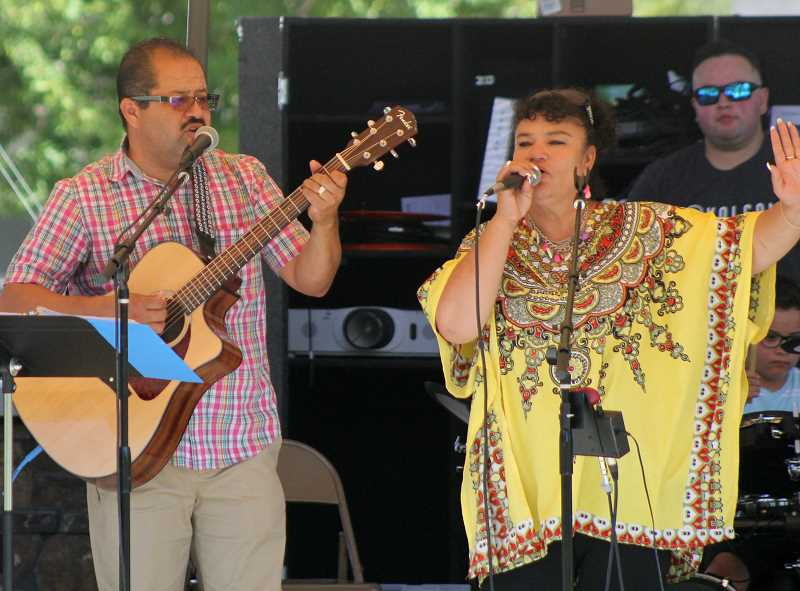 STEELE HAUGEN/MADRAS PIONEER - Jose and Nora Adame take the stage at the 12th annual Our Community in the Park event at Sahalee Park on Saturday, which saw increased attendance.