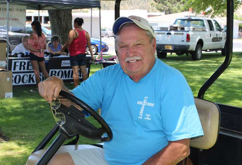 HOLLY M. GILL/MADRAS PIONEER - Organizer Gary Buss drives around the park to ensure that everything is running smoothly.