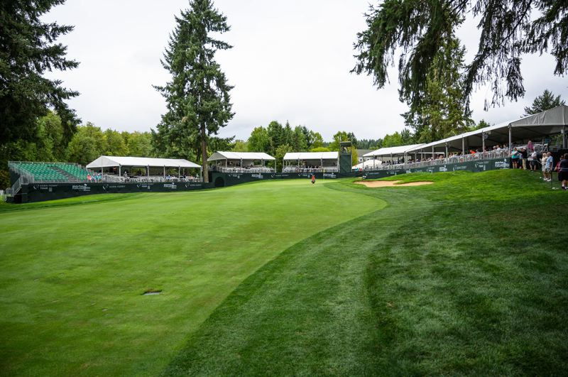 PMG PHOTO: CHRISTOPHER OERTELL - The 18th green and fans around it await the golfers during Thursday's first round of the WinCo Foods Portland Open at Pumpkin Ridge.