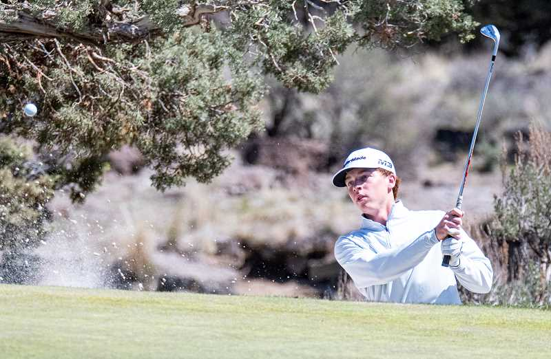 CENTRAL OREGONIAN FILE PHOTO - Mayson Tibbs hits a shot out of a bunker at Pronghorn's Jack Nicklaus golf course two years ago during his freshman year in college. Tibbs was named an All-American earlier this year.