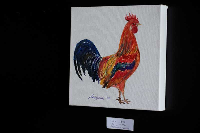PMG PHOTO: CLARA HOWELL  - The rooster and hen paintings are a mixture of ink and watercolor on canvas.
