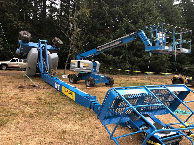 COURTESY PHOTO: CLACKAMAS COUNTY SHERIFF'S OFFICE  - A hydraulic cherry picker toppled over at the Pickathon festival site on Thursday, Aug. 8, killing the two arborists working in the metal basket on top (at bottom right).
