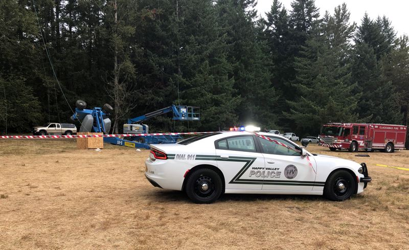 COURTESY PHOTO: CLACKAMAS COUNTY SHERIFF'S OFFICE  - Happy Valley police and Clackamas County Fire emergency personnel respond to a fatal accident at Pendarvis Farm in Happy Valley, the site of the annual Pickathon music festival. On Thursday, Aug. 8, two workers breaking down a shade system from a hydraulic cherry picker were killed when the tall piece of equipment toppled over, investigators say.