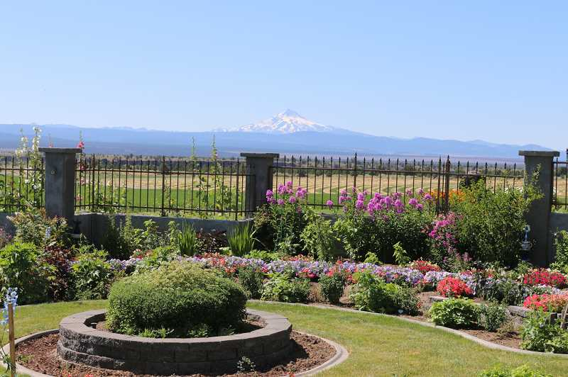 SUBMITTED PHOTO - A beautiful garden, with spectacular views was on display at the home of Karen and Vern Barre, in Culver, during the 2019 High Desert Garden Tour. The tour, presented by OSU Extension and the Central Oregon chapter of OSU Master Gardeners, sold 252 tickets to view Jefferson County gardens.