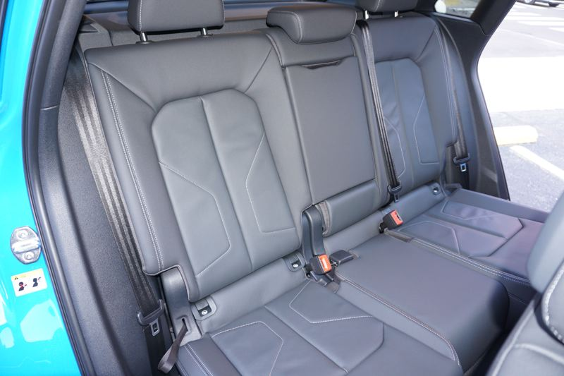 PMG PHOTO; JEFF ZURCHMEIDE - The rear seats slide forward and back almost 6 inches, and they recline for excellent comfort.