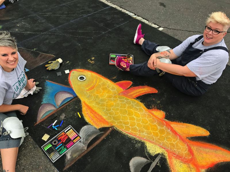 PMG PHOTO: DANA HAYNES - Kate Kristiansen of Beaverton, right, and Vanessa Sanne of Hillsboro create a montage of fish.