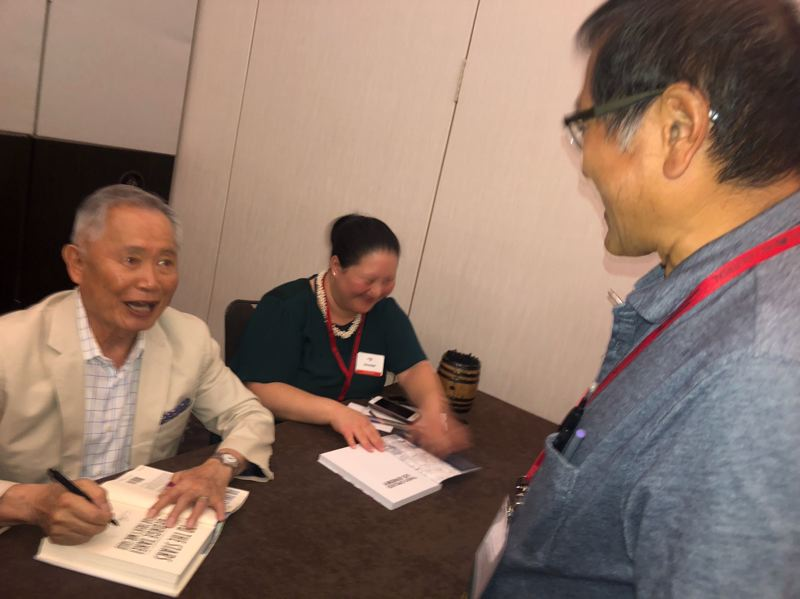 PHOTO COURTESY VENICE BUHAIN - George Takei, left, with Pamplin Media Group reporter Peter Wong at the national convention of the Asian American Journalists Association on Saturday, Aug. 3, in Atlanta.