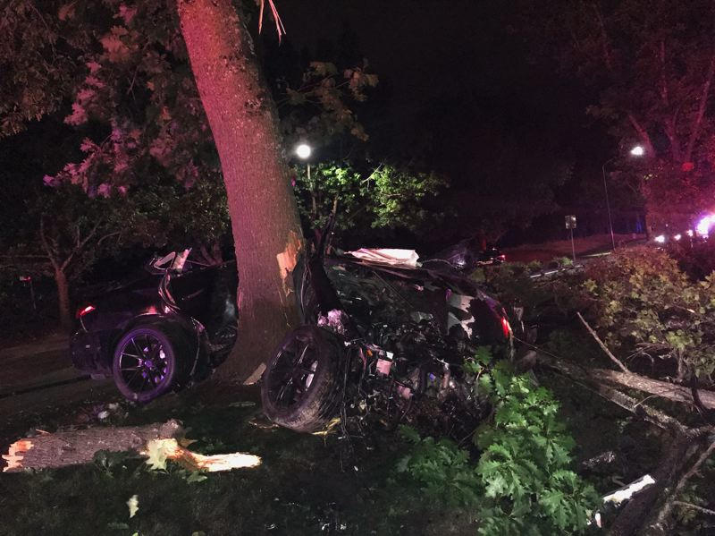 COURTESY PHOTO: HILLSBORO POLICE DEPARTMENT - The driver and passenger in this car were critically injured after the driver lost control of the vehicle and hit a tree near the Hillsboro Airport late Saturday night, Aug. 10, according to the Hillsboro Police Department.