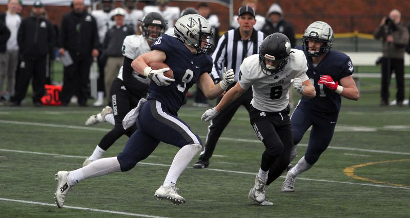 PMG PHOTO: MILES VANCE - Lake Oswego running back Casey Filkins added yet another honor to his junior football season when he was named Oregon Sports Awards' Prep Football Player of the Year in July.