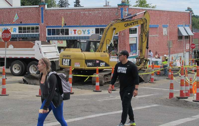 PMG PHOTO: BILL GALLAGHER - This pohoto was taken on Friday, Aug. 1 at the intersection of Southwest Captiol HIghway and 35th. The gaping hole in front of Thinker Toys wil be filled and paved over for Multnomah Days.