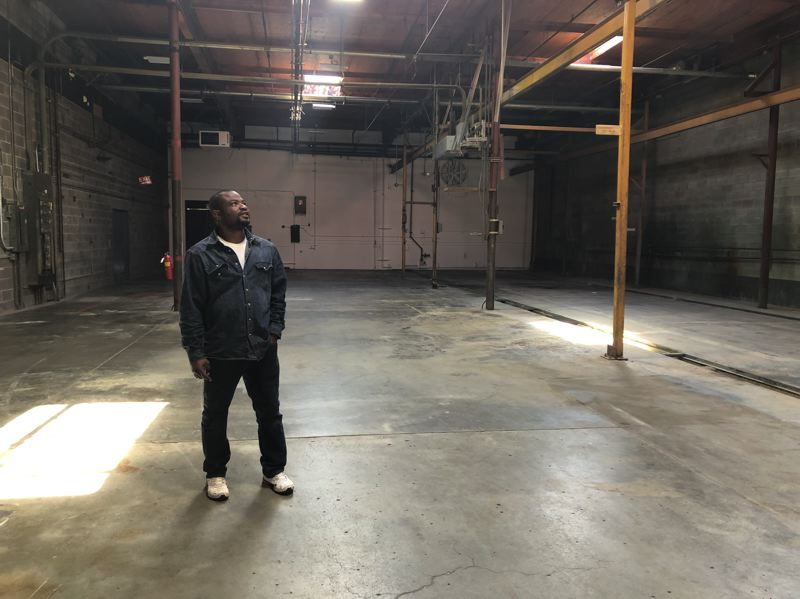 PMG PHOTO: STEPHANIE BASALYGA - Abdias Calixte, owner of Complete Fusion Welding, standing in a space in a flex-office building that he's considering leasing in order to start his own fabrication shop.