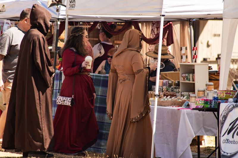 PHOTO BY KRISTA STONE - Costumed visitors to last year's Undersized Renaissance Faire at the Milwaukie-Portland Elks Lodge check out the vendors selling a variety of products.