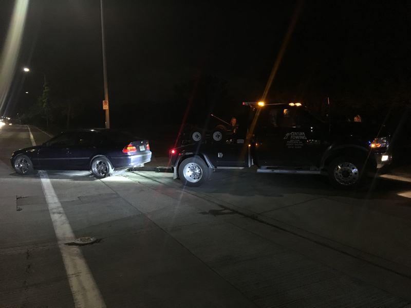 VIA PPB - A vehicle is towed during a street racing enforcement mission in Portland.