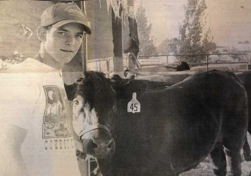 CENTRAL OREGONIAN FILE PHOTO - AUGUST 11, 1994: Brett Goodman, of the Crook County FFA, stands with his angus cross steer at the fair, which runs through Sunday.