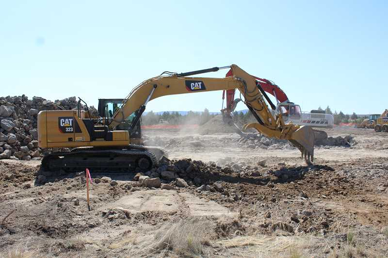 JASON CHANEY - The helibase is going in on the north end of the airport. Ground clearing recently began and the contract calls for the facility to be up and running by next April.