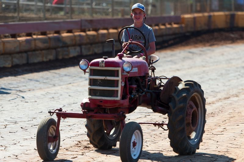 PMG PHOTO: CHRISTOPHER OERTELL - Noah Van Hoomissen of Banks steers his tractor after driving in the pull competition held at Sunset Speedway last year.
