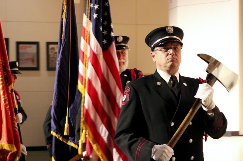 PMG PHOTO: ZANE SPARLING - A Portland Fire & Rescue Color Guard marched down the aisle of the Moriarty Auditorium during a ceremony on the Cascade Campus of Portland Community College in North Portland.