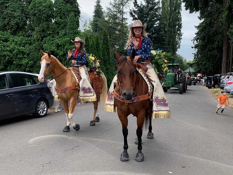 CAROL ROSEN - There was even some rodeo royalty on the streets of Aurora Saturday morning.