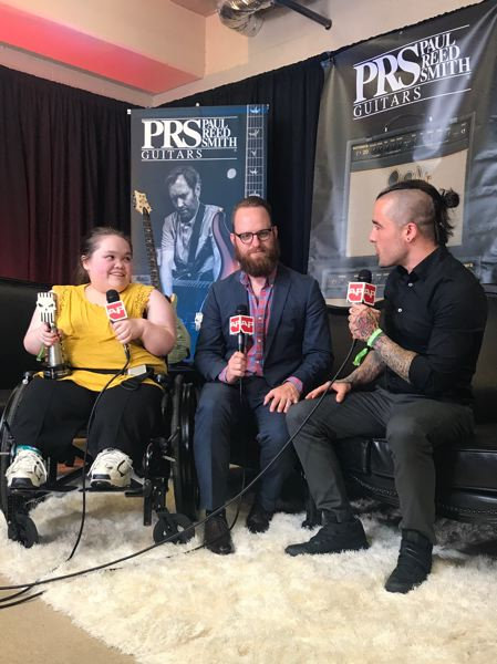 COURTESY PHOTO: CASSIE WILSON - Cassie Wilson holds her SubCity award. Next to her is Dan Campbell, vocalist for the band The Wonder Years, who was the ambassador for the grant. Interviewing them is Stevie James from Alternative Press.