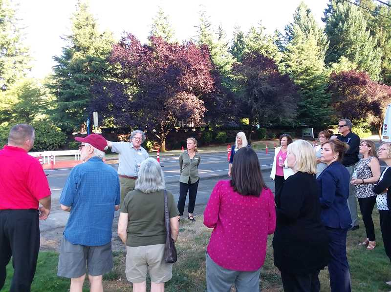 PMG PHOTO: RAY PITZ - Tualatin Public Works Director Jeff Fuchs points out planned improvements for Boones Ferry Road and Siletz Drive during a traffic bond tour Monday evening.