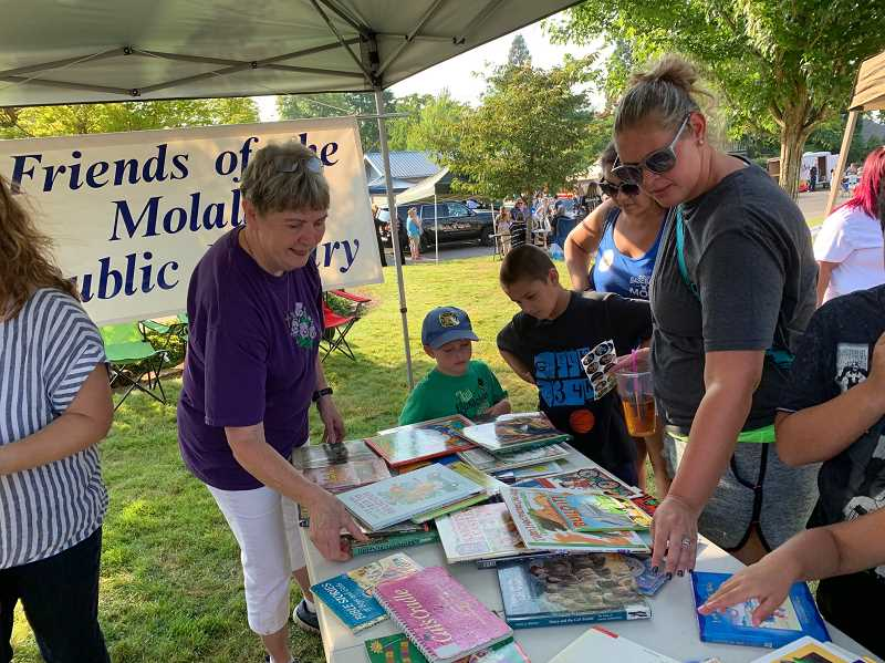 CAROL ROSEN - There were safety tips, food vendors and even a free book table from the Friends of the Molalla Public Library during this year's National Night Out celebration.