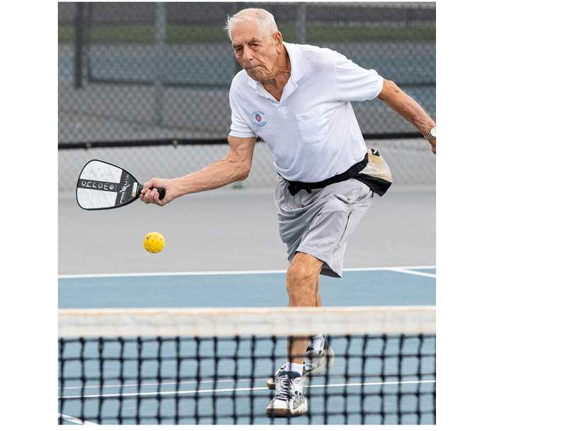 LON AUSTIN/CENTRAL OREGONIAN - Marvin Cunningham plays a shot during a recent pickleball game at the Crook County High School tennis courts. Cunningham, who is 88, attended Crook County High School in 1946 when he was a junior in high school. After working as a club professional racquetball player in St. Helens, Cunningham and his wife moved to Prineville a few years ago.