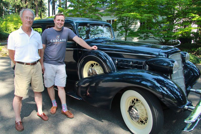 PMG PHOTO SAM STITES - Mike (left) and Miles Eshaia post with their 1934 Cadillac outside of the Oswego Heritage House and Museum.