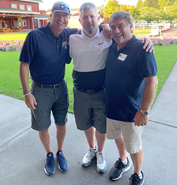 COURTESY PHOTO - Lake Oswego baseball coach Jake Anders (left) and football coach Steve Coury (right) flank Mike Warmanen after Warmanen's hole-in-one at Sunday's Laker Open won him $10,000.