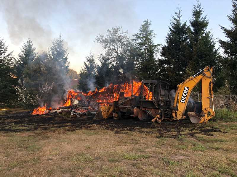 COURTESY PHOTO: LAKE OSWEGO FIRE DEPARTMENT - The fire originated at a stump in the corner of the property, but the cause remained unknown Tuesday afternoon.