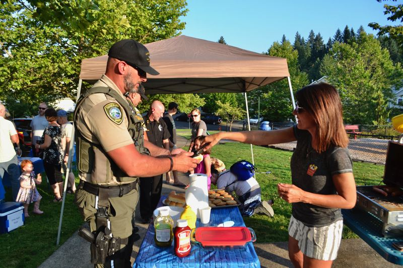 PMG PHOTO: BRITTANY ALLEN - Some Clackamas County Sheriff's deputies stopped by Barlow Ridge Park during National Night Out on Aug. 6.