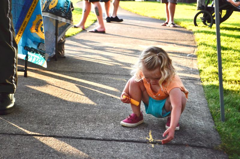 PMG PHOTO: BRITTANY ALLEN - Sidewalk chalk was a big draw for children at Barlow Ridge Park during National Night Out on Aug. 6.