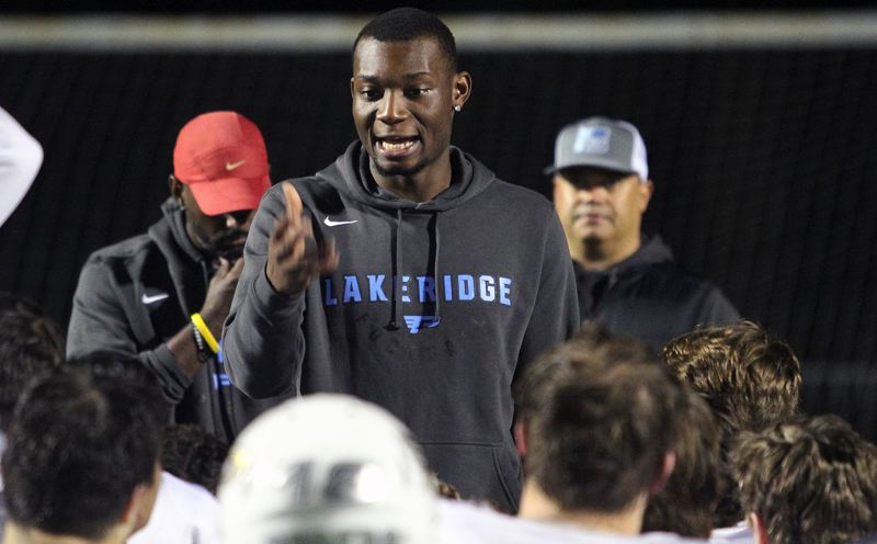 PMG PHOTO: MILES VANCE - Elvis Akpla (here addressing his team during the 2018 season) announced his resignation as Lakeridge head football coach on July 31 after accepting a teaching job in Missouri.