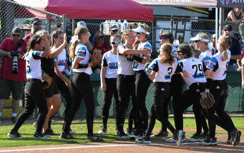 TIMES PHOTO: MATT SINGLEDECKER - Team Oregon outfielder Sophia Groshong and her teammates celebrate a big out against Southeast.