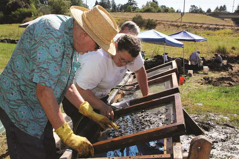 PMG FILE PHOTO - Community members are invited out to the stream bed in front of Woodburn High School on Aug. 20-25 to take part in the science departments annual paleontology dig.