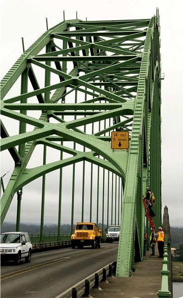 COURTESY PHOTO: ODOT - ODOT crews inspect the Yaquina Bay Bridge in Newport. The Lincoln County city pushed back an attempt to veto state funds to replace two local dams.