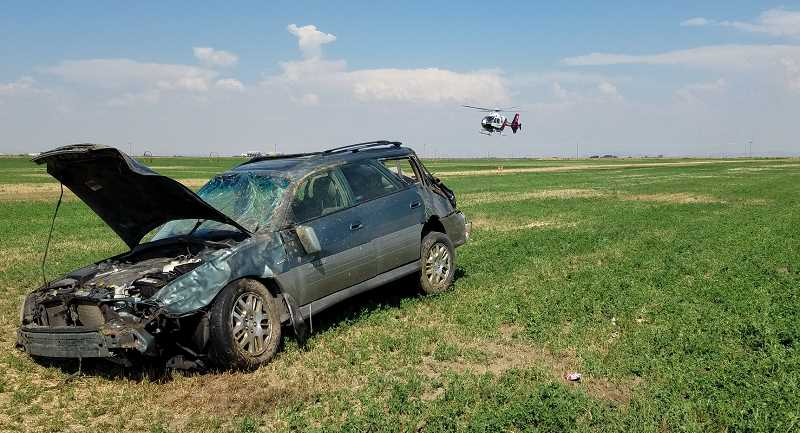 SUBMITTED PHOTO - A Subaru station wagon ended up in a field following a single-vehicle crash on Aug. 7, which fatally injured a Madras man. In the photo, Air Life is about to land.