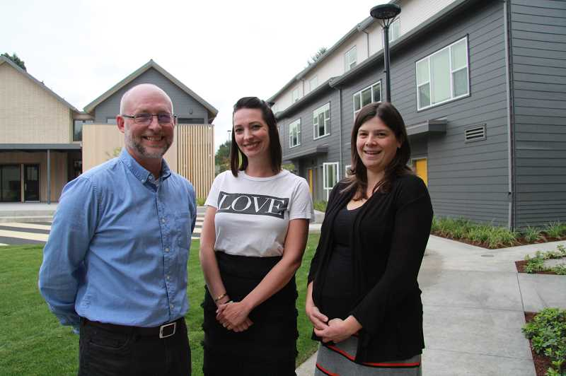 PMG PHOTO: SAM STITES - NHA Executive Director Trell Anderson (left) Director of Resource Development Kristen Barber (center) and Grants/Communications Specialist Katie Ash pose in the courtyard of their organization's newly renovated campus in Milwaukie.