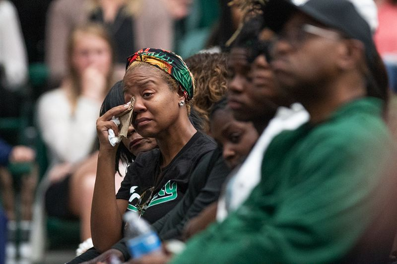 PMG PHOTO: JONATHAN HOUSE - Tears flow in the crowd on Wednesday as friends and community members honor the life of Deante Strickland during a memorial at Portland State's Viking Pavilion.
