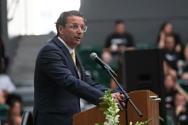 PMG PHOTO: JONATHAN HOUSE - Barret Peery, men's basketball coach at Portland State, delivers the opening remarks on Wednesday in a tribute at Viking Pavilion to former PSU athlete Deante Strickland.