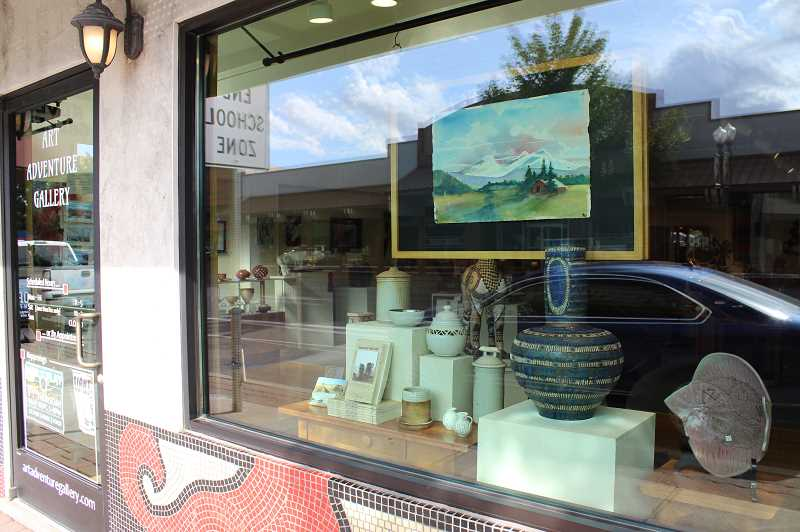 HOLLY M. GILL/MADRAS PIONEER - The outside window of the gallery is now well-lit, with a variety of types of artwork on display, including some that are for sale.