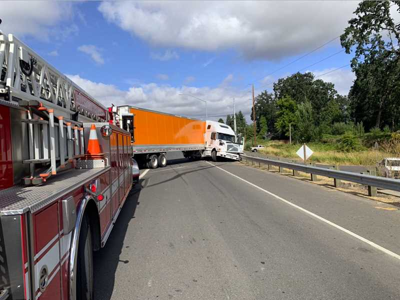 COURTESY PHOTO - A closer look at the semi-truck, which jackknifed and crashed into a barricade on Thursday morning.