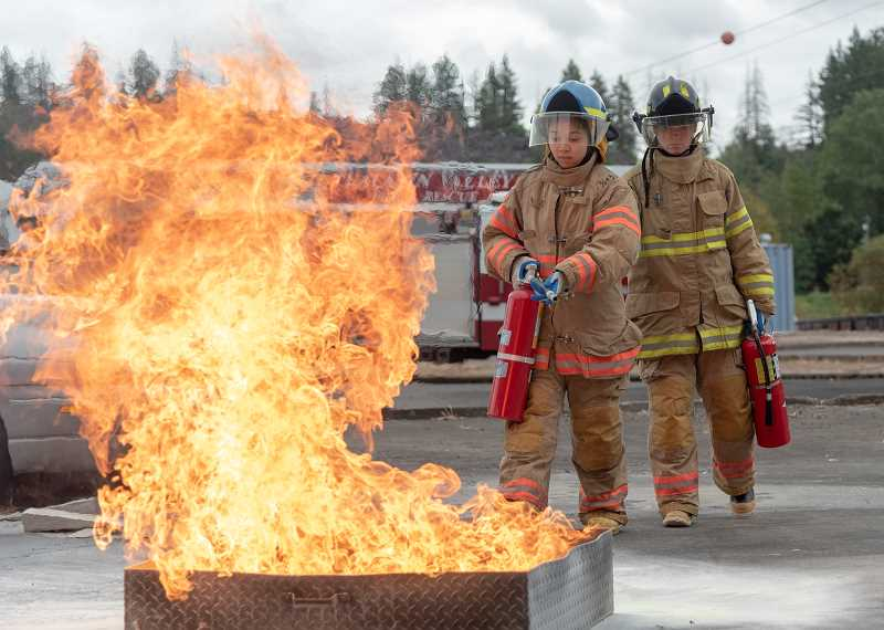 COURTESY PHOTO  - Females in the Metro Fire Camp learned to extinguish fires.