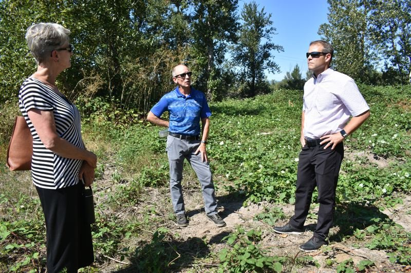 PMG PHOTO: SHANNON O. WELLS  - Metro Councilor Shirley Craddick, Troutdale City Manager Ray Young and Mayor Casey Ryan discuss plans for a trail and promenade park along the Sandy River.   6) Ryan points to the right of way, marked by the wooden stake at center, where the proposed trail and promenade park will be developed.   7) A map of the 40 Mile Loop trail in East Multnomah County depicts unfinished sections as a broken red line, including one by Depot Park, near bottom right. COURTESY GRAPHIC: METRO regional government