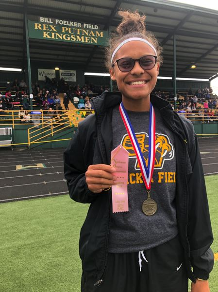 PMG PHOTO: STEVE BRANDON - Savannah Hoffmann of St. Helens High placed in district this year as a junior in the high jump, long jump and triple jump, then went on to take sixth at the state meet in the high jump.
