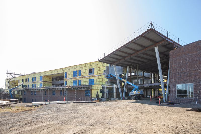 TRIBUNE PHOTO: JONATHAN HOUSE - The exterior of the new Sherwood High School will feature brick veneer, steel and expanses of glass.